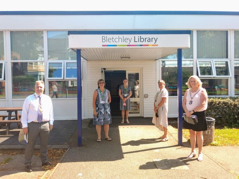 Photo of the Mayor of Milton Keynes, Cllr Angela Kennedy and Bletchley Library staff standing outside the library